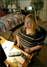 woman on headset at computer at home